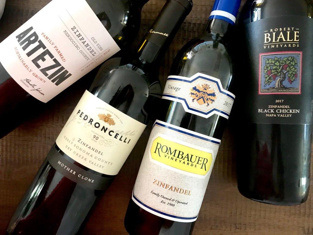Four bottles of Zinfandel wine
