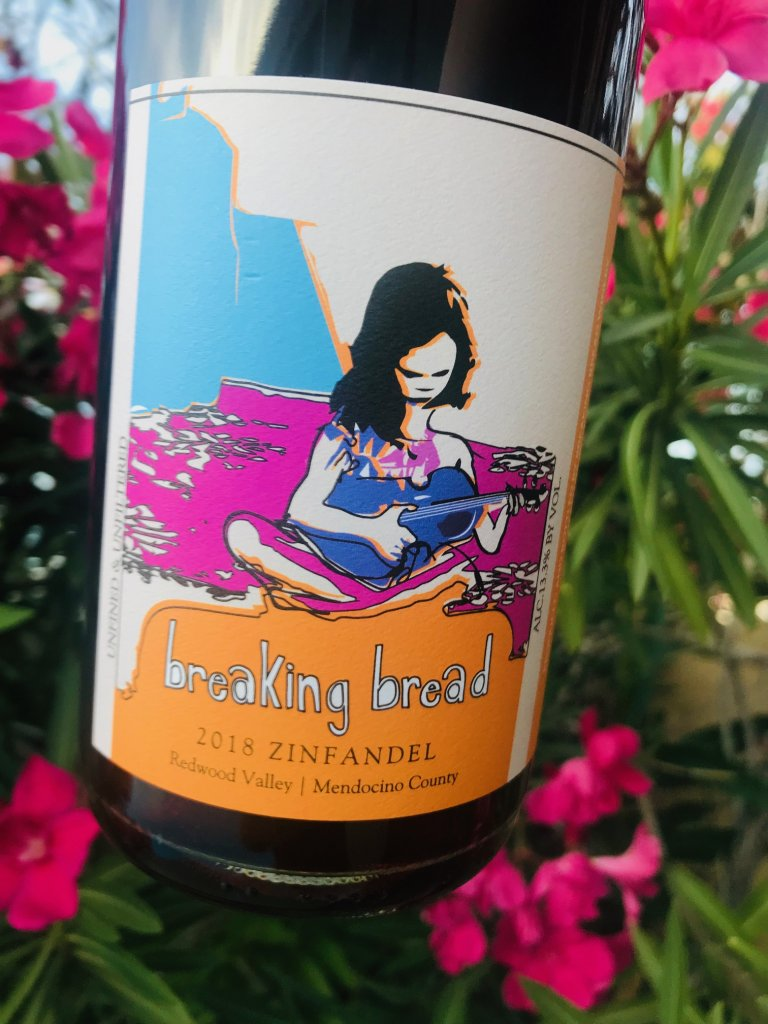 Breaking Bread bottle of wine. The label has a girl with dark hair holding a small guitar