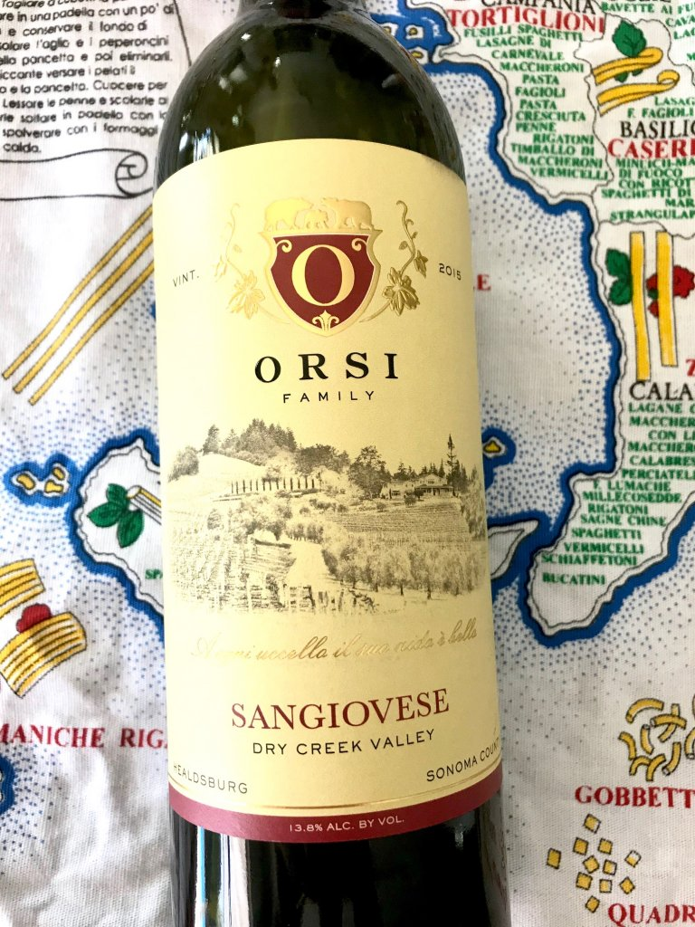 Orsi Family Vineyards bottle of wine. Sangiovese with a classic image in black of a vineyard and family crest in red, with a yellow background